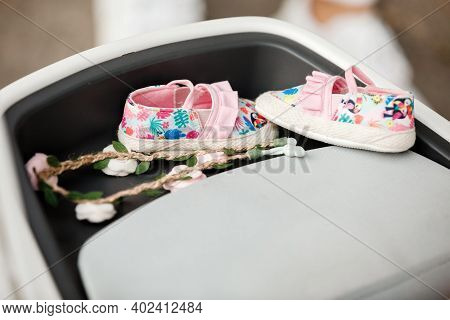 Cute Floral Baby Girl Shoes. Stylish Baby Shoes And Baby Hair Decoration In Flowers. Childhood. Sele