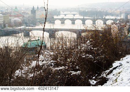 Prague, Czech Republic. 01-08-2021. View Bridge Historical Town Of Prague From Park Letna During Sno