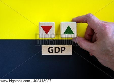 Gdp, Gross Domestic Product Symbol. Businessman Holds A Cube With Up Icon. Wooden Block With Word 'g