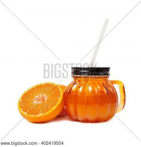 Glass Jar Of Fresh Orange Juice With Slice Of Tangerine Or Mandarin Orange Fruit Isolated On White B