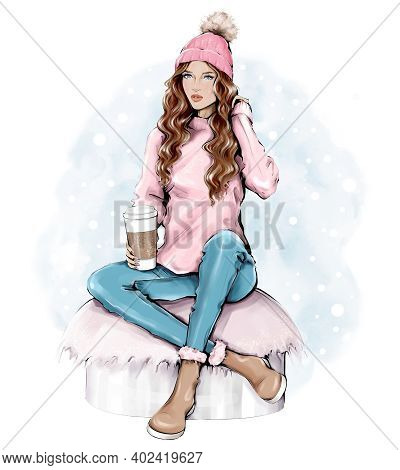 Beautiful Young Woman In Warm Knitted Hat. Trendy Casual Fashion Winter Outfit. Pretty Woman Holding
