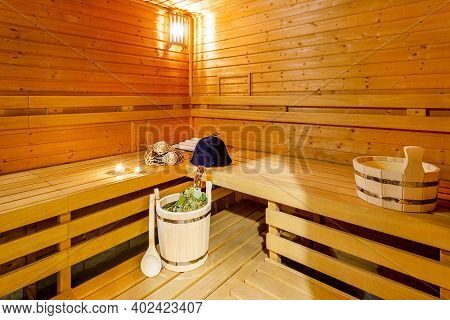 Interior Of Classic Wooden Finnish Sauna With Accessories