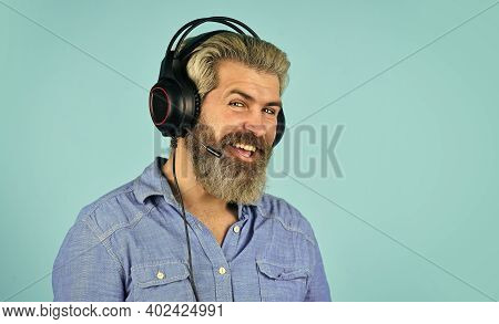 Time To Relax. Brutal Hipster Wear Earphone. Singing And Dancing. Enjoying His Favorite Music. Man L