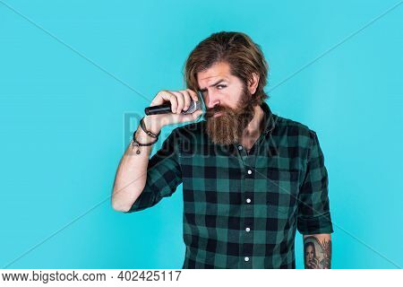 Casual Fashion Styled Singer. Modern Looking Bearded Hipster With Mic. Music Concept. Brutal Handsom