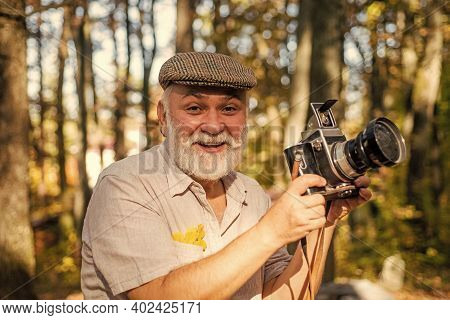 Cameraman Outdoors. Landscape And Nature Photo. Old Photographer Filming. Professional Photographer.