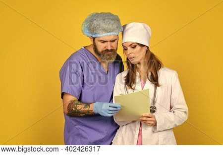 What Do You Think. Study Patient Medical Record. Make A Diagnosis. Doctor On Duty Discuss Diagnose.