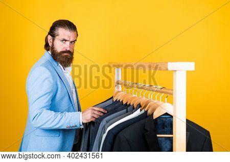 Glamour Fashion Model. Formal Dress Code. Bearded Hipster Use Apparel In Male Atelier. Male Wardrobe