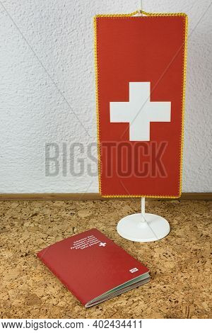 Zurich, Switzerland - January 2, 2021: Swiss National Flag And Swiss Passport - National Identity An