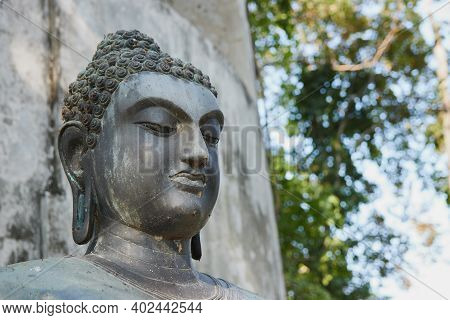Phayao, Thailand - Dec 6, 2020: Front Right Headshot Buddha Statue On Forest Background In Wat Anala