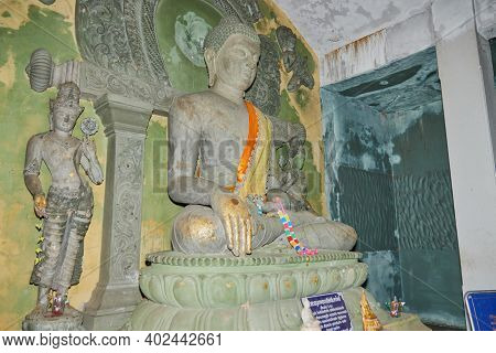 Phayao, Thailand - Dec 6, 2020: Front Right Stone Buddha Statue In Stone Sanctuary Or Chapel At Wat