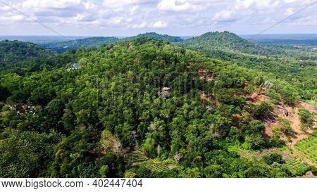 Drone Aerial View To Tangkiling Borneo In A Clear But Cloudy Sky. Green Rain Forest View. Panorama F