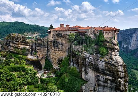 Cliff Top Varlaam Monastery In Meteora, Greece In Typical Meteora Landscape Of Rocky Pillars And Slo
