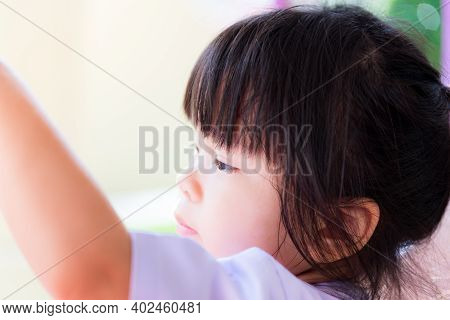 Close Up Shot Child Looking At Ahead  With Curious Expression Face, Side View Portrait Of Kid Alone