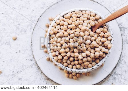 Raw Chickpeas On A Bowl. Chickpeas Is Nutritious Food. Healthy And Vegetarian Food. Top View.