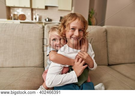 Portrait Of Cute Siblings, Little Boy And Girl Smiling At Camera, Embracing Each Other, Showing Love