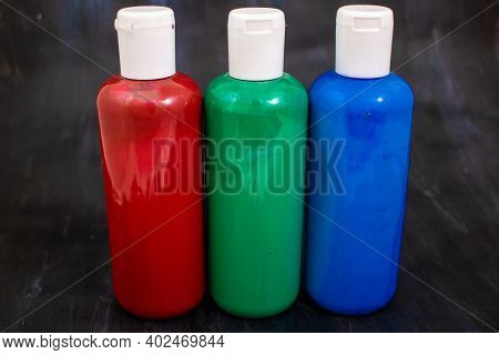 Three Bottles Of Acrylic Paint In The Order Red, Green, Blue, The Primary Colors Of The Additive Rgb