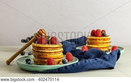 Tasty American Pancakes With Raspberries, Blueberries, And Honey. Family Breakfast Concept With Copy