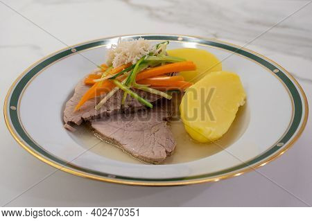 Stewed Pork With Root Vegetable Julienne Of Carrots, Leeks, Horseradish And Potatoes Called Steirisc