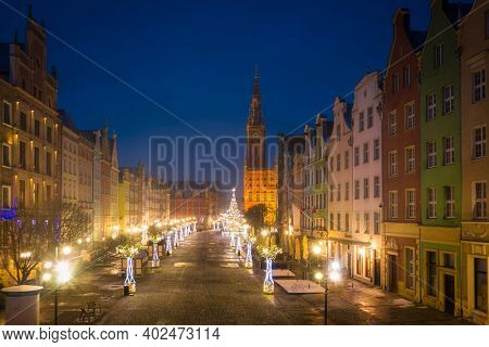 Gdansk, Poland - January 2, 2021: Christmas decorations in the old town of Gdansk at dusk, Poland