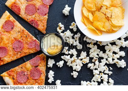 Fast Food And Unhealthy Eating Concept. Close Up Of Fastfood Snacks: Pizza, Popcorn And Potato Chips