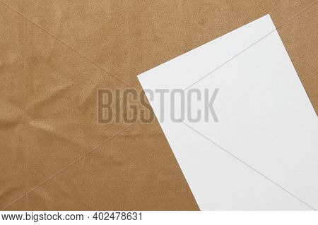 Template Of White Paper Lies Diagonally On Light Brown Cloth Background. Concept Of Business Plan An
