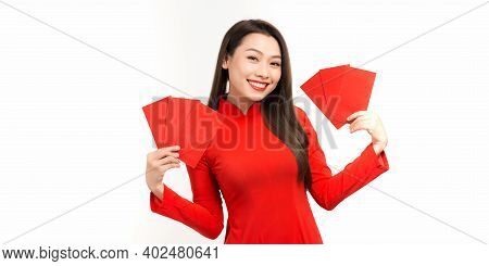 Beautiful Asian Woman Wear Ao Dai And Take Red Envelopes In Chinese New Year On White Isolate Backgr