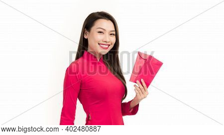 Beauty Woman Wear Ao Dai And Take Red Envelopes In Lunar New Year