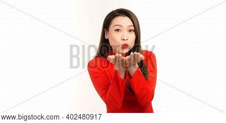 Portrait Of Beautiful Asian Woman In Ao Dai Dress Sending An Air Kiss