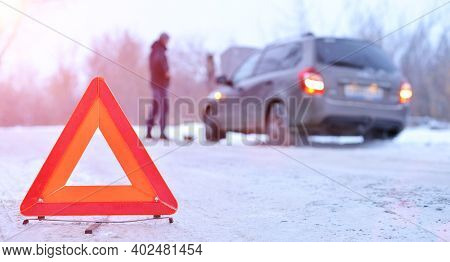 Car Repair On The Road In Winter. Car Triangle On Winter Road. Problem With Vehicle On Snowy Road. B