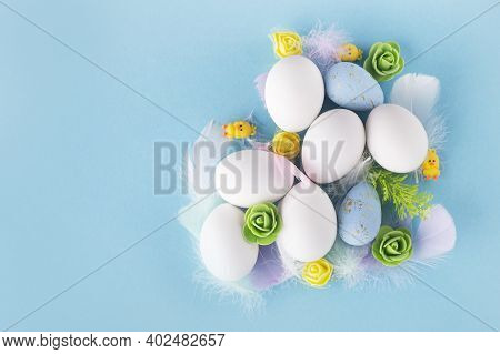 Easter Background With Easter Eggs And Decor On Blue Backdrop