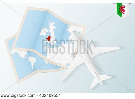 Travel To Wales, Top View Airplane With Map And Flag Of Wales. Travel And Tourism Banner Design.