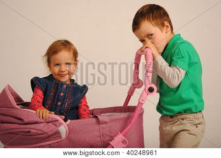 Two kids with a carriage.