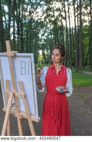 Beautiful Woman In Red Dress In Summer In Park And Forest, Draws Picture, Creating Creativity And Cr
