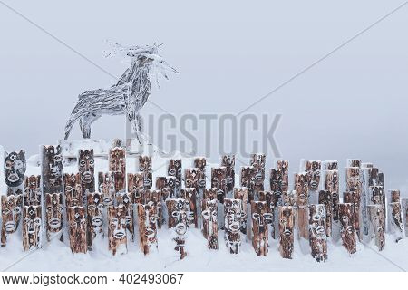 Perm Krai, Russia - January 02, 2021: Snow-covered Art Object In The Form Of A Group Of Idols Depict