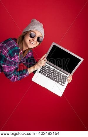 Close-up Portrait Of Crazy Mad Overjoyed Beautiful Smiling Happy Young Woman Holding Netbook Compute