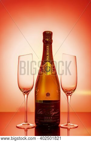 Beautiful View Champagne Bottle  Pol Roger, And  Two  Slim, Tall And Elegant Champagne Glasses On Re
