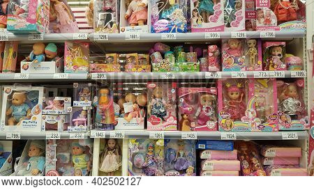 Russia, St. Petersburg 02.01.2021 Packages With Dolls For Sale In A Supermarket