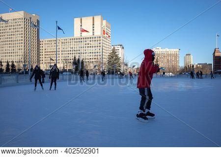 Ottawa, Ontario, Canada - January 8, 2021: People Enjoy Skating On The Rink Of Dreams Refrigerated O