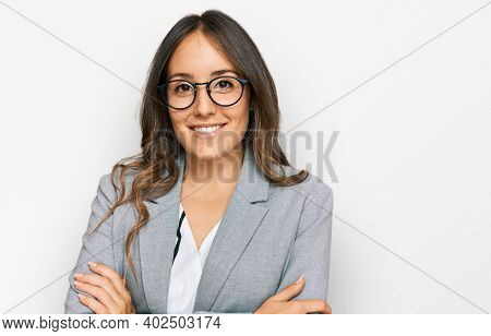 Young brunette woman wearing business clothes happy face smiling with crossed arms looking at the camera. positive person.