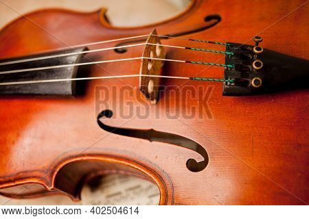 Photo Of Violin Close-up. Close-up Of Cello Strings, Classical Music Concept. Detail Of A Violin. Th