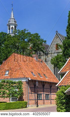 Half Timbered House And Church Tower In Ootmarsum, Netherlands