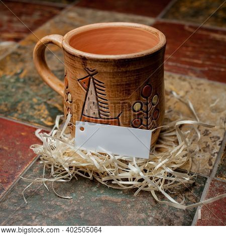 Clay Brown Mug , Mugs With A Pattern, Stand On The Tile. Clay Mug With A Pattern. Painted Clay Mug O