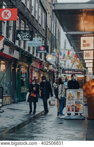 London, Uk - November 19, 2020: People Wearing Face Masks In Chinatown Area In London. Chinatown Is