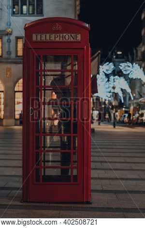 London, Uk - November 19, 2020: Red Phone Box On Bond Street, London, Christmas Lights On The Backgr