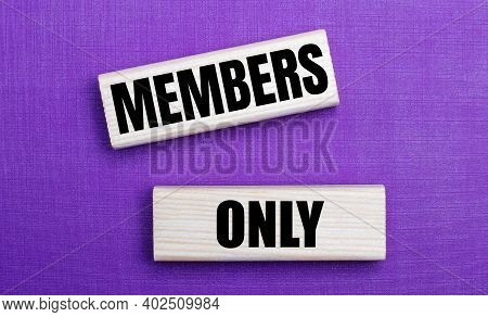 On A Lilac Bright Background, Light Wooden Blocks With The Text Members Only