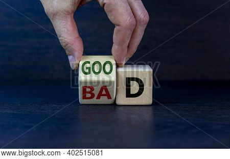 Good Or Bad Symbol. Businessman Hand Turns A Cube And Changes The Word 'bad' To 'good'. Beautiful Da