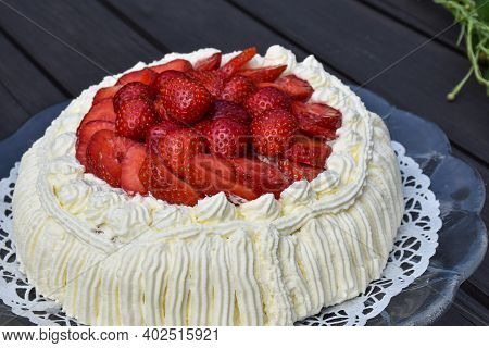 Strawberry Cream Cake Close Up On A Garden Table