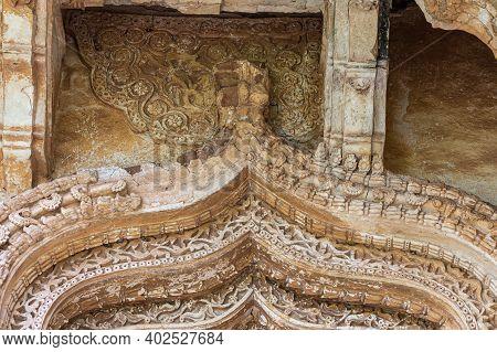 Hampi, Karnataka, India - November 5, 2013: Zanana Enclosure. Closeup Of Damaged Decorated Brown Sto