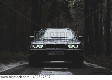 Chernigov, Ukraine - January 6, 2021: Old Car Bmw 7 Series (e38) On The Road In The Forest. Bmw In T