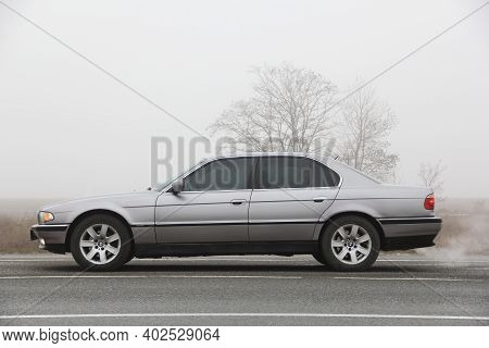Chernigov, Ukraine - January 6, 2021: Old Car Bmw 7 Series (e38) On The Road Against A Background Of
